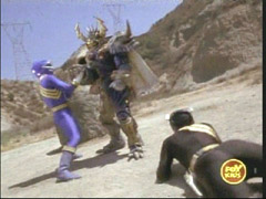 Black and Blue Rangers fight a Mutorg